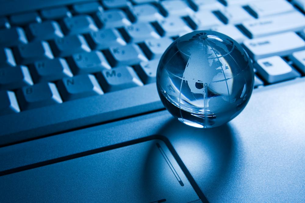 transparent globe on a laptop  keyboard